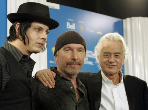 Guitarists White, The Edge and Page attend news conference at Toronto International Film Festival